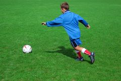 Football game. Young soccer player Royalty Free Stock Photo