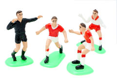 Football is a game. Plastic figures of footballers-built in the playing position Stock Photo