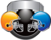 Football game. Silver football trophy with two helmets facing each other Royalty Free Stock Photography