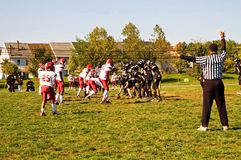 Football game scrimmage Stock Photography