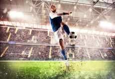 Football game at the stadium. Football player play in a stadium with audience Stock Image