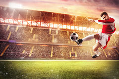 Football game at the stadium. Football player play in a stadium with audience royalty free stock photography