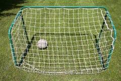 Football gate on green grassy playground. Soccer goal Stock Image