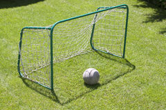 Football gate on green grassy playground. Soccer goal Stock Photography