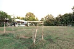 Football gate on a rustic football field Stock Photos