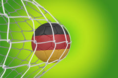 Football in germany colours at back of net Royalty Free Stock Image