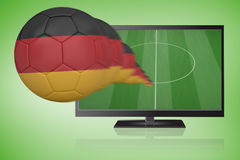 Football in germany colours flying out of tv Stock Photography