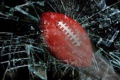 Football through glass. stock photos