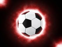 Football glowing red. Isolated on black background Royalty Free Stock Images