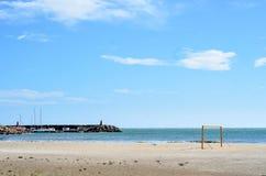 Football goal in the beach with blue sky Stock Photos