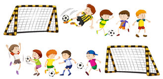 Football goal and boys playing ball Royalty Free Stock Image