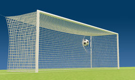 Football goal with flies into the net football ball Royalty Free Stock Photos