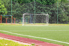 Football goal on a green field on a background Royalty Free Stock Photo
