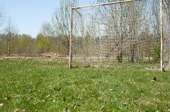 Football goal on a green field of grass Stock Photos