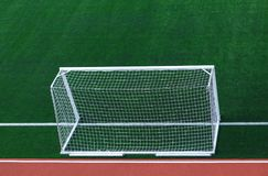 Football goal on the green football field from the back side stock image