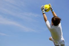 Football Goal Keeper. Soccer Football Goalie making diving save royalty free stock photos