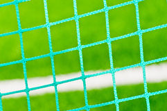 Football  goal mesh on the field. Background Stock Photos