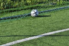 Football in the goal net Royalty Free Stock Images