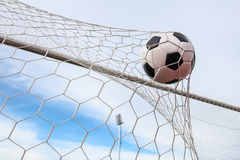 Football in the goal net Royalty Free Stock Image