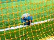 Football in goal net Royalty Free Stock Photo
