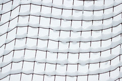 Football goal net, covered with snow Stock Photos