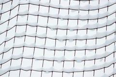 Football goal net, covered with snow Stock Photos