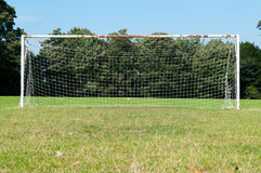 Football goal posts and net on a soccer pitch. Football pitch goal posts and net on a soccer pitch Royalty Free Stock Image