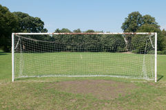 Football goal posts and net on a soccer pitch. Football pitch goal posts and net on a soccer pitch Royalty Free Stock Photo