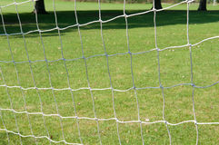 Football goal posts and net on a soccer pitch. Football pitch goal posts and net on a soccer pitch Stock Images