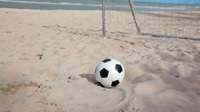 Football and goal on sand beach and blue sky background in HD, dolly tracking camera shot at day light time stock video