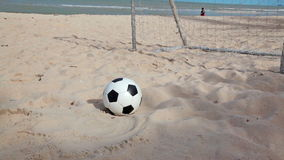 Football and goal on sand beach and blue sky background in HD, dolly tracking camera shot at day light time stock footage