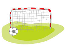 Football goal and soccer ball. Isolated football goal and soccer ball on grass Royalty Free Stock Photography