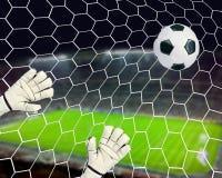 Football, goal. Soccer or football, goalkeeper misses the ball, a goal Stock Image