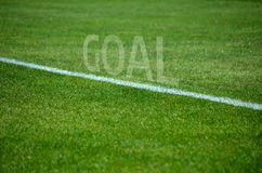 Football Goal text on grass with white lane Stock Photos