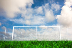 Football goal under blue cloudy sky Royalty Free Stock Images