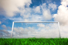 Football goal under blue cloudy sky Stock Images