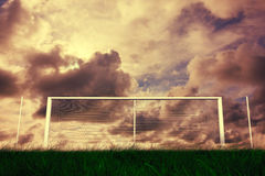 Football goal under cloudy sky Royalty Free Stock Photos