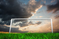 Football goal under cloudy sky Stock Photos