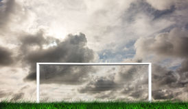 Football goal under grey cloudy sky Stock Photos