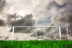 Football goal under grey cloudy sky Stock Images