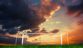 Football goal under orange cloudy sky Stock Photos