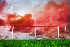 Football goal under red cloudy sky Stock Image