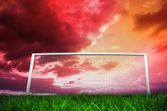 Football goal under red cloudy sky Royalty Free Stock Photo