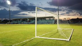 Football goal with the white mesh on a green lawn in the evening Royalty Free Stock Photo