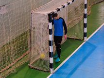 Football goalkeeper on goal, field, Futsal ball field in the gym indoor, Soccer sport field. Football goalkeeper on goal, field, Small Futsal ball field in the Stock Photography