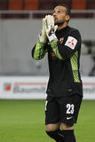 Football goalkeeper praying Stock Photo