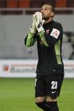 Football goalkeeper praying stock photo
