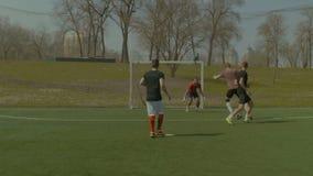 Football goalkeeper saving goal during match stock footage