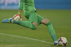 Football goalkeeper shooting ball. Football action: football goalkeeper (Ciprian Tatarusanu - Steaua Bucharest) shooting the ball on the grass field during the Royalty Free Stock Photo