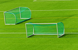 Football goals on football field. Football goals next to each other  on football field Stock Image